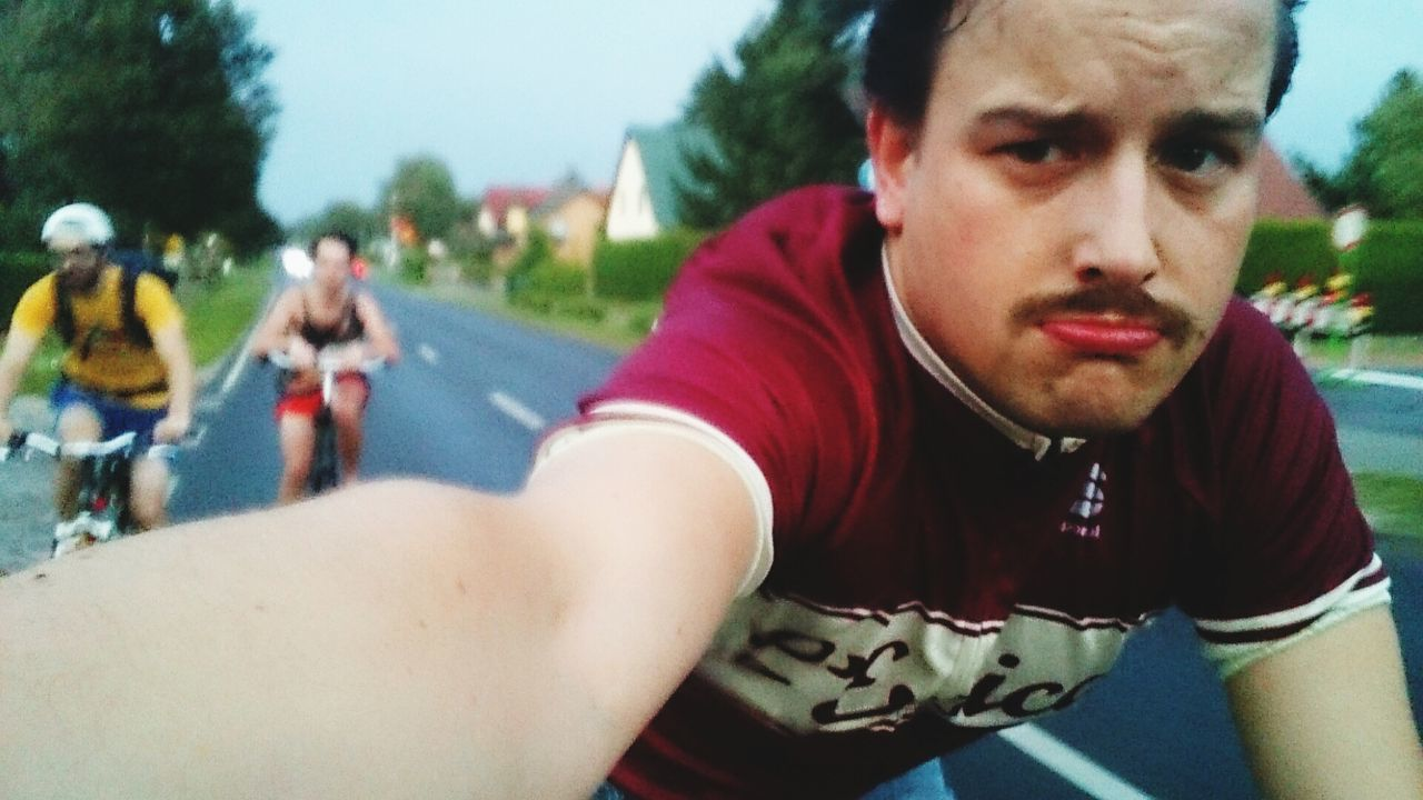 Portrait of man riding bicycle on street