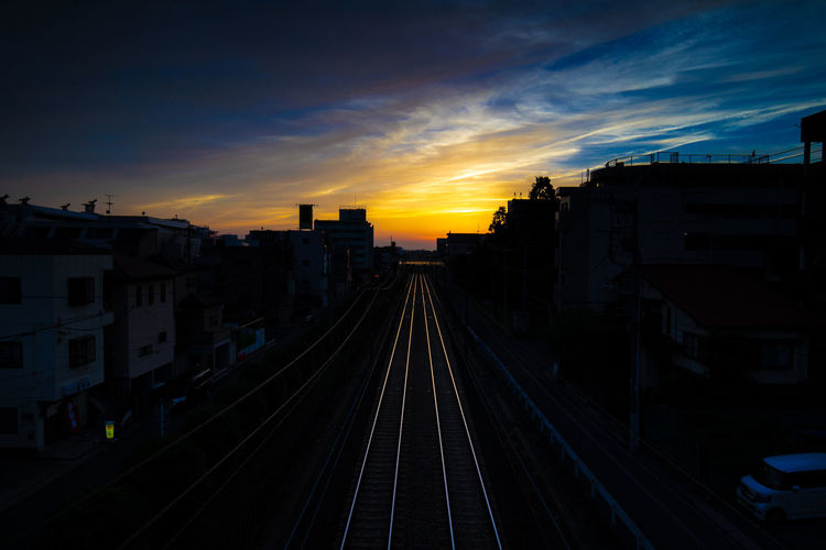 Tadaa Community Hello World Sunset Architecture Track Railroad Track Built Structure Rail Transportation Building Exterior Sky Cloud - Sky Transportation Building City Nature No People Public Transportation The Way Forward Outdoors Direction Mode Of Transportation Orange Color Long