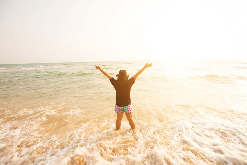 Adult Arms Outstretched Arms Raised Beach Beauty Carefree Cheerful Freedom Fun Happiness Healthy Lifestyle Horizon Over Water Human Arm Human Body Part One Person One Woman Only Only Women Outdoors People Portrait Relaxation Sea Sunlight Vacations Wellbeing
