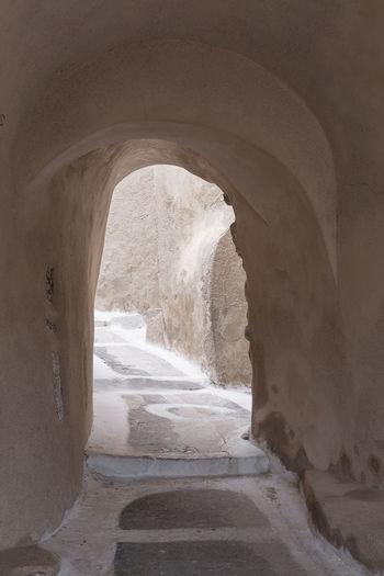 Archway amidst sea seen through tunnel