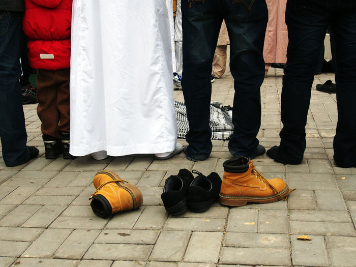 Muslims congregate to celebrate Muslim holiday of Eid al-Adha, Great Mosque, Lugansk, Ukraine Adult Adults Only Celebrate Congregate Day Eid Al-Adha Great Holiday Human Body Part Human Leg Low Section Lugansk Men Mosque Muslim Muslims Only Men Outdoors People Real People Shoe Standing