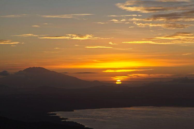 Sunrise over Taal Lake, Philippines Taal Lake Landscape Mountain Scenery Scenics Sky Sun Sunrise Sunset Taal Water