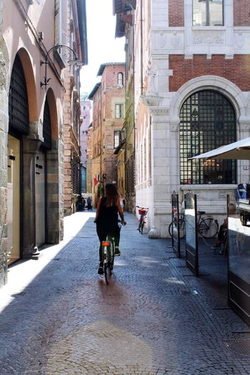 Lucca Italy Lucca Italy Architecture Built Structure Building Exterior City Transportation Real People Bicycle Mode Of Transportation Street Lifestyles Land Vehicle Day Building The Way Forward Riding
