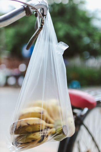 Banana Bag Bottle Close-up Container Day Focus On Foreground Food Food And Drink Freshness Glass - Material Hanging Nature No People Outdoors Plant Plastic Plastic Bag Transportation
