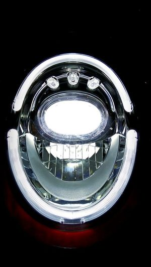 High angle view of illuminated electric lamp against black background