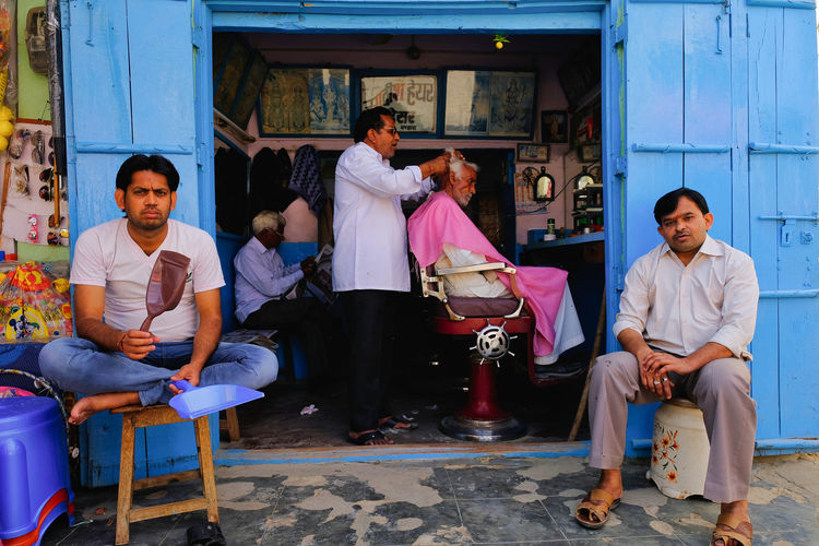 Daily life of street market in Mandawa, India. Historical Building Old Town Adult Casual Clothing Chair Front View Full Length Group Of People Historical Leisure Activity Lifestyles Males  Mandawa Mature Adult Mature Men Men People Portrait Real People Seat Sitting Women Young Adult Young Men