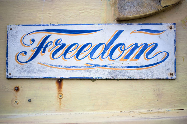 Text Communication Western Script Day No People Sign Blue Architecture Close-up Outdoors Old Metal Paint Information Art And Craft Wall Message Freedom