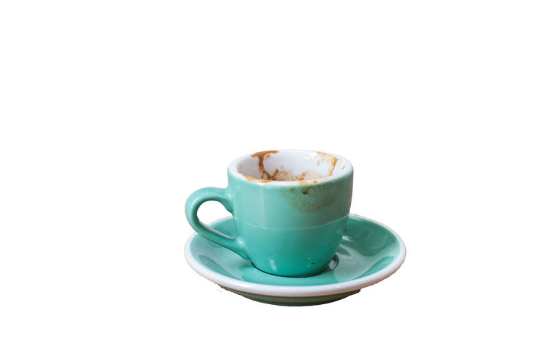 Used Green coffee cup on a plate on a white background – Hot tasty and sweet drink with foam served in a mug for breakfast - Fresh black beverage used for energy Coffee Crockery Refreshment Food And Drink Drink Coffee - Drink Mug Cup Coffee Cup White Background Saucer Studio Shot Indoors  Copy Space Still Life Frothy Drink Cut Out Hot Drink Cappuccino Freshness No People Latte Non-alcoholic Beverage Tea Cup Isolated Breakfast Cafe Latte Caffeine Coffee Dirty Green Beverage Hot Espresso Backgrounds Wooden Vertebrate Closeup Glass Morning Ceramic Shop Lifestyles Break Blank Empty Used Asian  Object