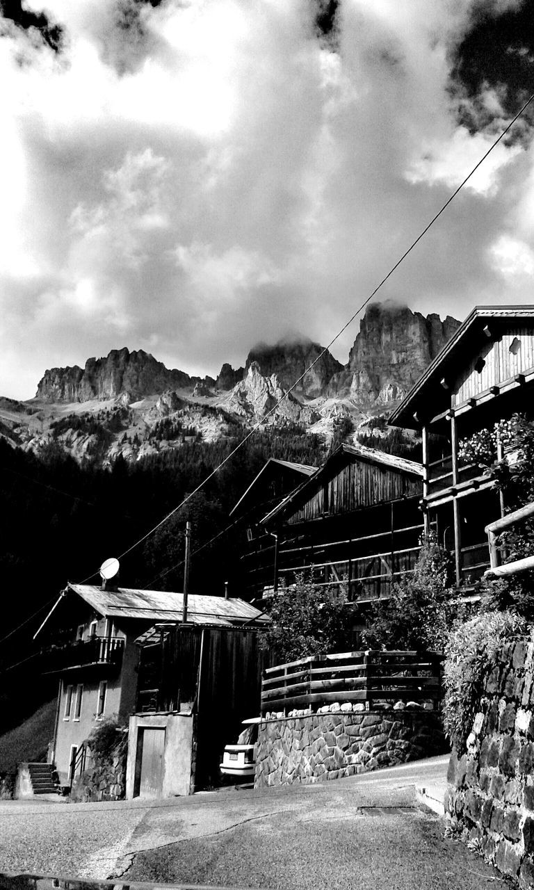 architecture, mountain, built structure, sky, building exterior, cloud - sky, day, no people, outdoors, cable, nature, tree