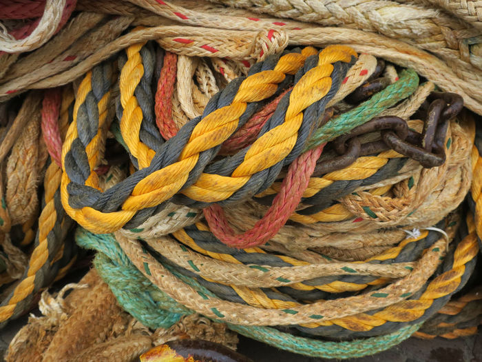multi colored bunch op ropes Braided Close-up Complexity Day Fishing Industry Focus On Foreground Full Frame High Angle View Intertwined Intricacy Multi Colored No People Pattern Rope Strength String Tangled Textile Textured  Tied Knot Twisted Yellow
