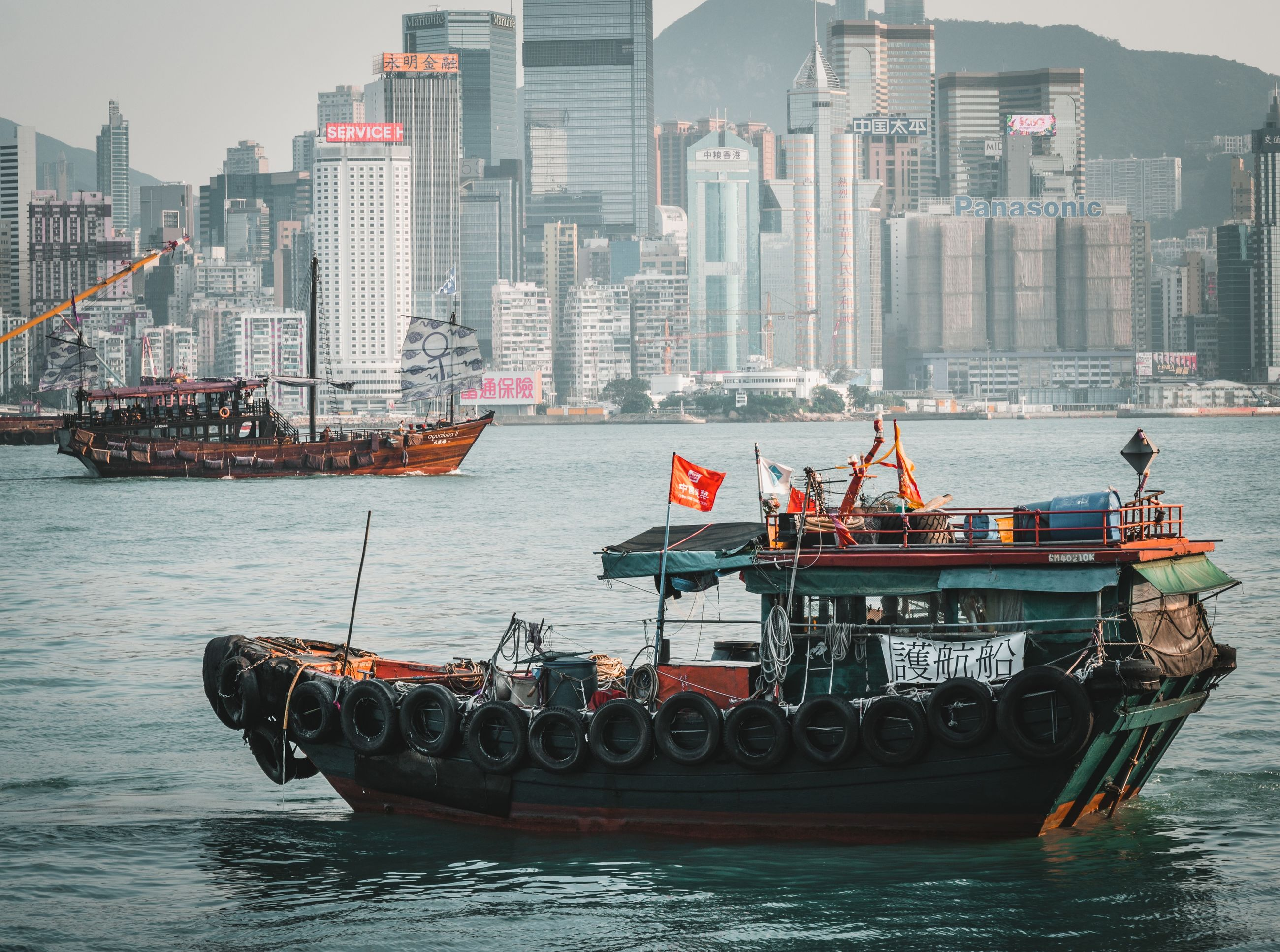 water, nautical vessel, transportation, architecture, waterfront, mode of transportation, built structure, building exterior, city, sea, nature, sky, building, travel, urban skyline, day, outdoors, cityscape, office building exterior, skyscraper