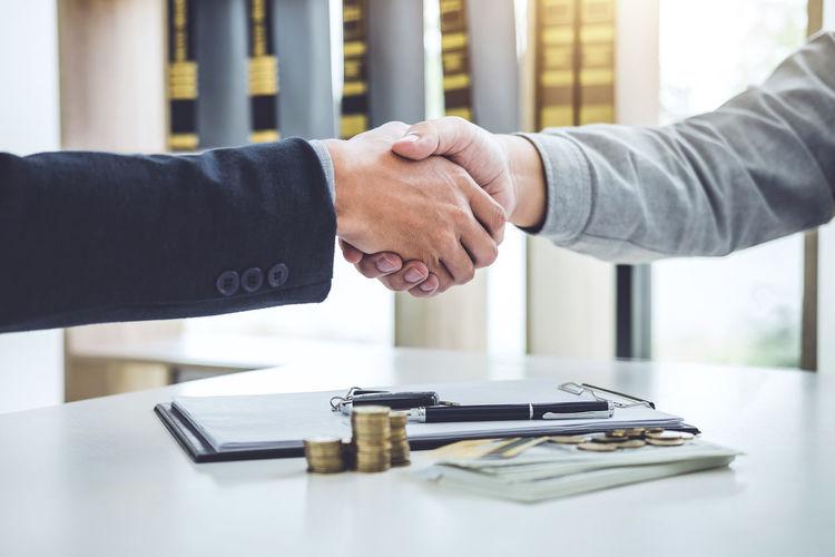 Cropped Image Of Businessmen Handshaking Over Desk