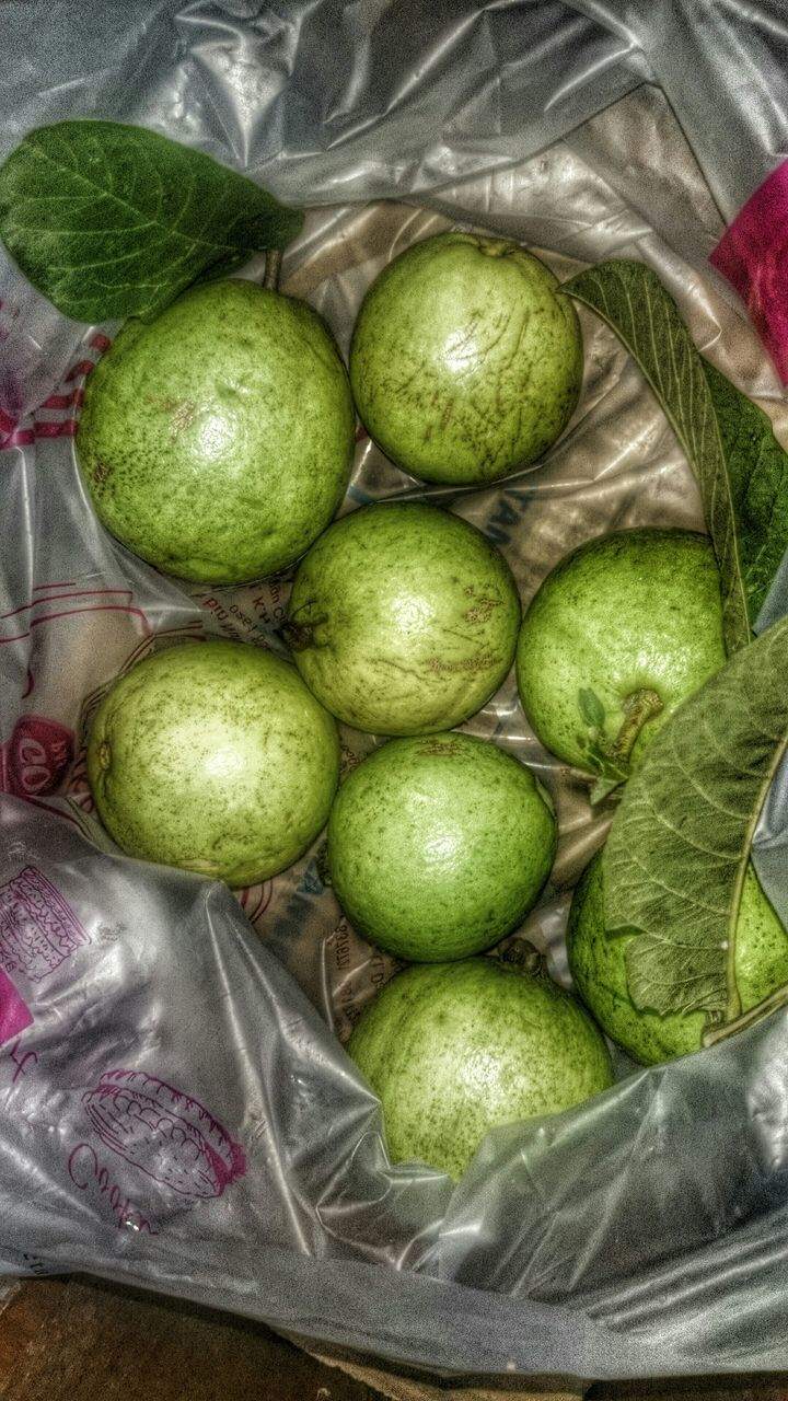 Close-Up Of Group Of Green Fruits