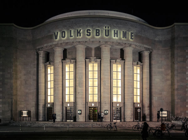 "The Volksbühne (""People's Theatre"") was built in 1913/1914. In the last years it has been establishing a reputation as one of the most provocative and experimental major theaters in contemporary Germany Architectural Column Architecture Berlin Berlin Mitte Berlin Photography Culture Façade Famous Place Frontal Shot Historical Building History Night Night Photography Theater Travel Destinations Western Script"