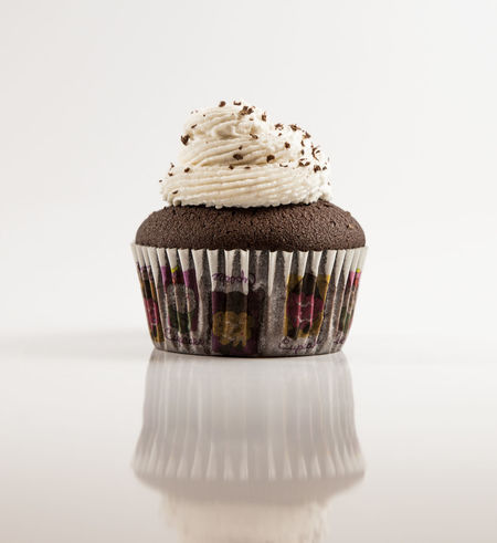 Chocolate Cupcake Close-up Cupcake Day Dessert Food Food And Drink Freshness Frosting Indoors  Indulgence No People Product Product Photography Reflection Studio Shot Sweet Food White Background