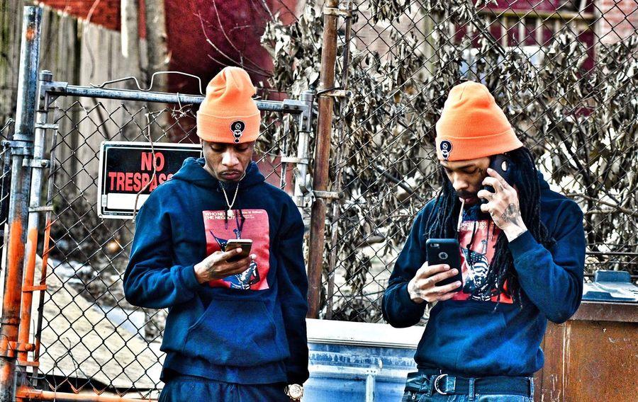 Two People Outdoors African American Man Urban Neighborhood Portrait Cellphone Dredlocks