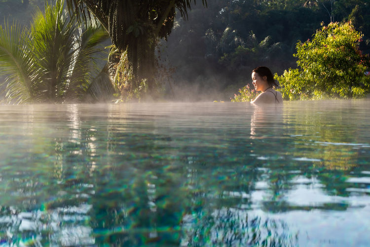 Woman swimming in infinity pool