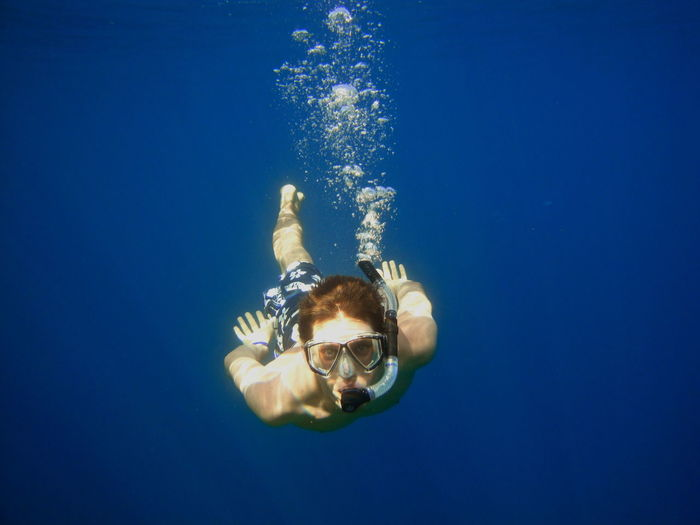Young man looking at camera while snorkeling