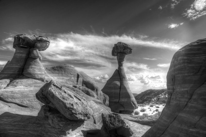 Statue of rock formations against cloudy sky