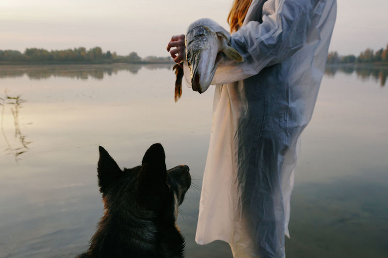 One Animal Pets Domestic Water Lifestyles Women Standing Nature Dog Lake Domestic Animals Fish Fishing Fisherman Lake View Morning Moment Watching Beast Waterfront Reflection Morning Light Hunting River Trees
