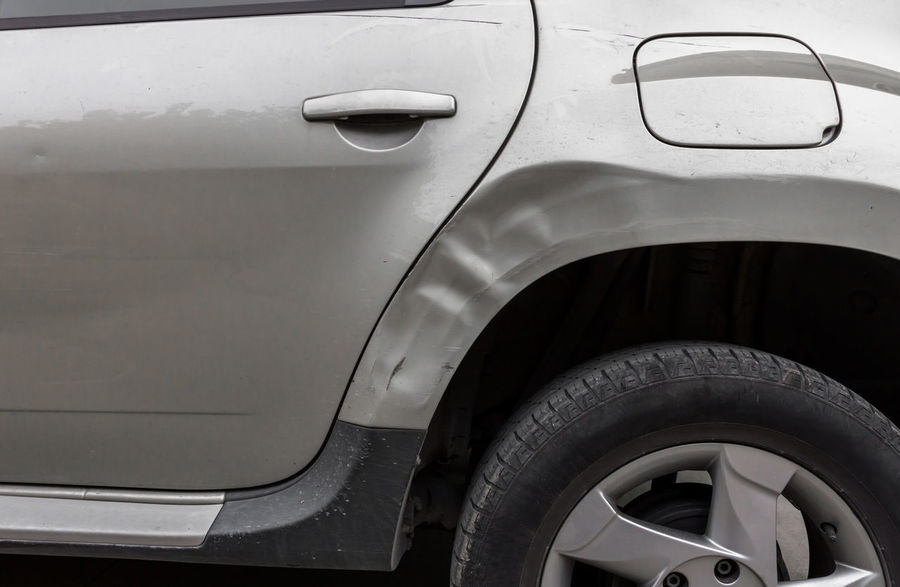 Dents on the car caused by the accident Automobile Crash Damage Deformation Fender Road Accident Auto Broken Bumper Car Collision Crush Damaged Dangerous Dent Dented Drive Injury Insurance Metal Rear Repair Safe Safety