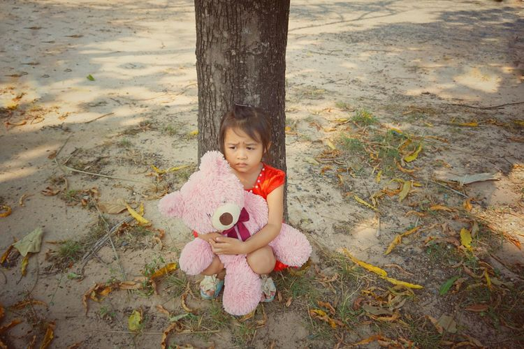 A lovely girl with pink bear Hug Little Floor Grass Hot Women Tired Mood Sad Tree Under Children Pink Red EyeEm Selects Child Childhood Stuffed Toy Smiling Happiness Teddy Bear Full Length Portrait Sand Cheerful Doll Felt Human Representation Toy Animal Growing