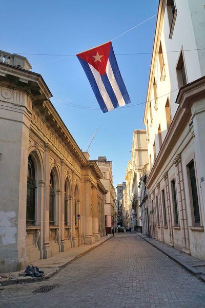 Travel Old Street Havana Cuba Cuban Flag Architecture Building Exterior Flag Built Structure Patriotism Day Outdoors Sky No People