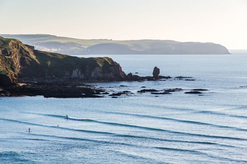 -1 UK Winter Perfection | Bantham Surf UKsurf Devon SouthDevon Offshore Water Sea Mountain Tranquil Scene Scenics Tranquility Beauty In Nature Clear Sky Nature Idyllic Shore Remote Sky Non-urban Scene Calm Mountain Range Solitude Cliff Waterfront Vacations