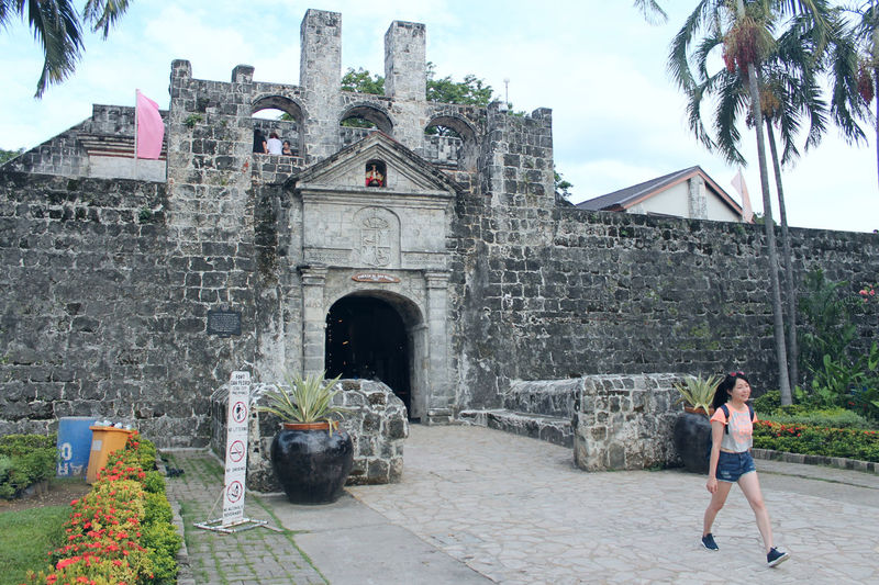 Architecture Building Building Exterior Built Structure Casual Clothing Day Full Length History Lifestyles Nature Old One Person Outdoors Place Of Worship Real People Sky The Fort Cebu The Past Travel Travel Destinations Women