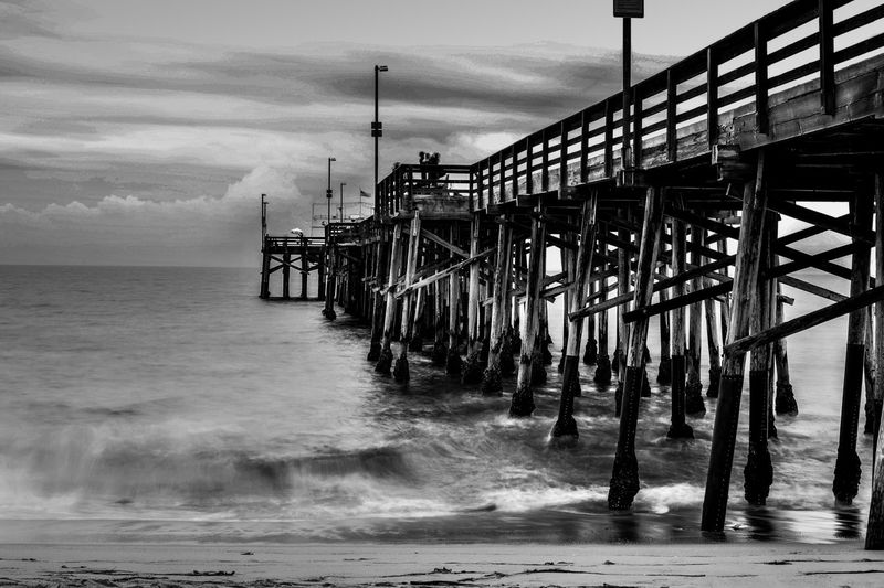 Beach Black And White No People Ocean Outdoors Overcast Pier Scenics Sea Shore Tranquil Scene