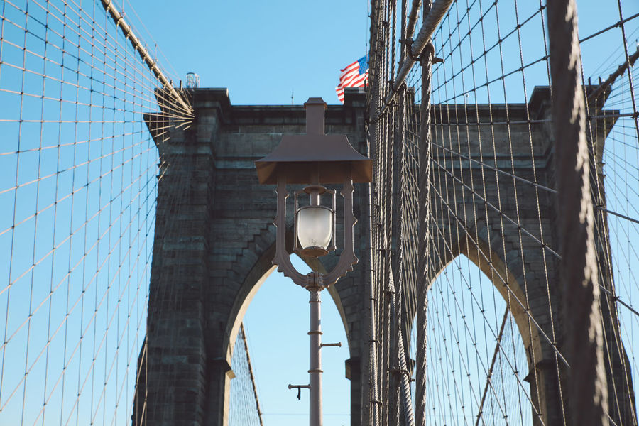 Architecture Brooklyn Bridge  Brooklyn Bridge / New York Building Exterior Built Structure City Cold Day Flag Low Angle View New York New York City No People Outdoors Patriotism Sky Sunny Winter