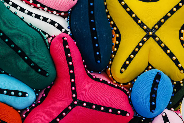 Multi Colored Close-up Fashion Blue No People Full Frame Backgrounds Indoors  Pattern High Angle View Variation Still Life Zipper Choice Bag Textile Shoe Retail  Directly Above Clothing Personal Accessory Luxury Pillow Colorfull Yellow Pink Color Group Of Pillow