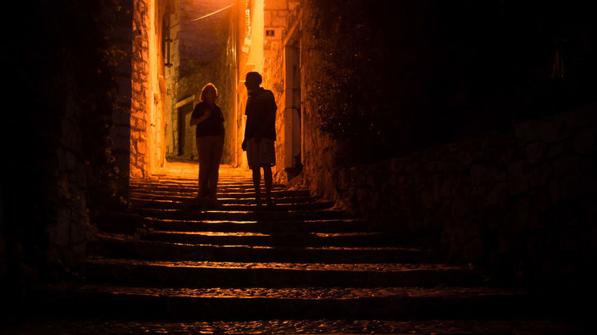 Night mood in summer. Sutivan-Croatian Darkness Architecture Built Structure Full Length Illuminated Men Night Night Mood Orange Color People Real People Silhouette Staircase Steps Steps And Staircases The Light The Light Within  The Way Forward Two People Women