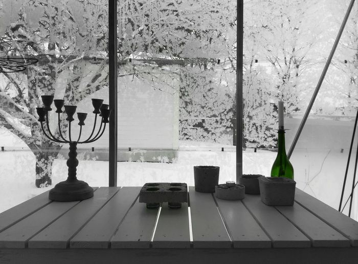 No People Winter Greenhouse Silhouettes Indoors  Frosted Glass Frosty Morning Glass Windows Greenhouse Decor Mood Captures Table Shadowy Candelabrum Green Glass Bottle Candle Cups Concrete