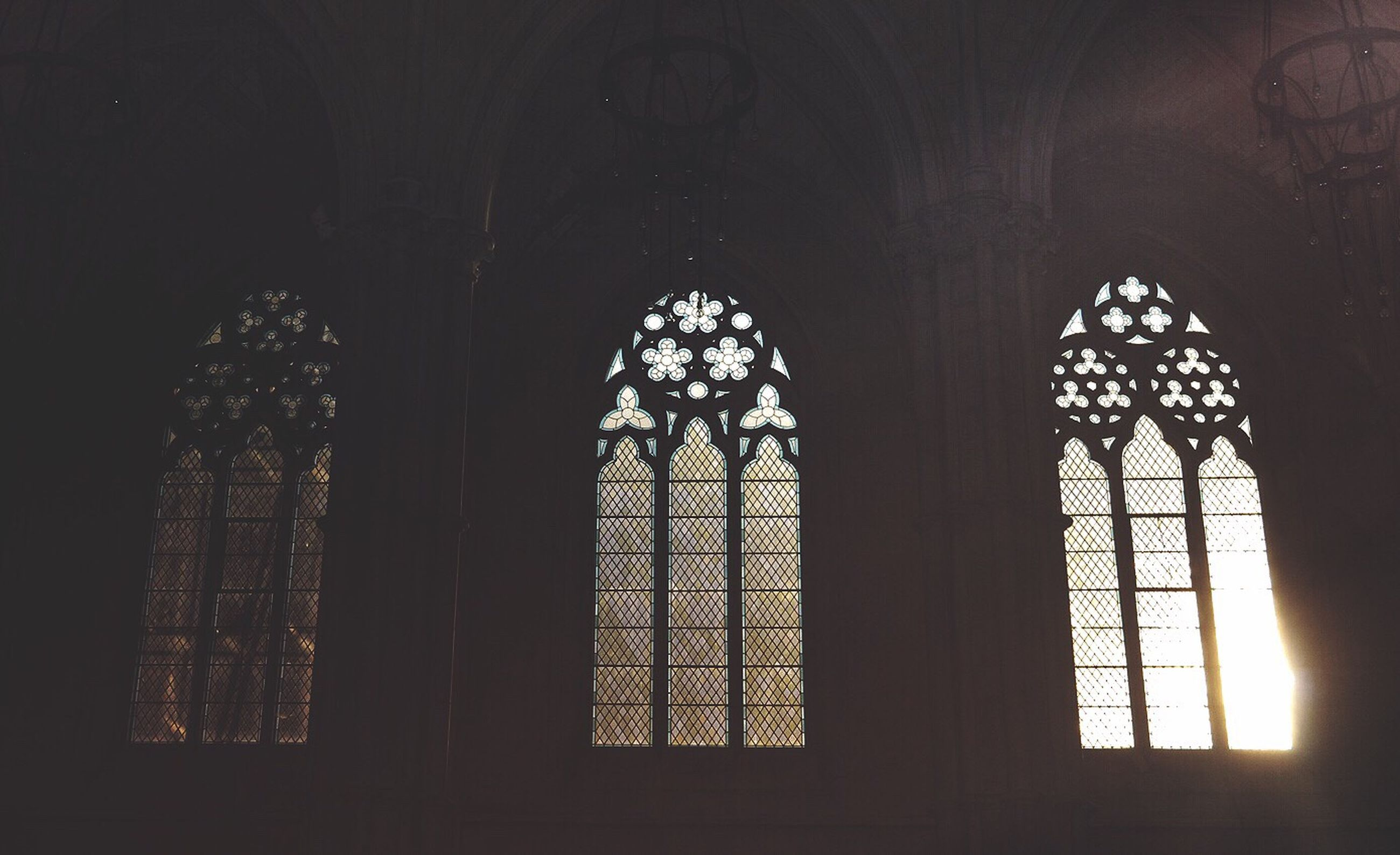 low angle view, window, indoors, no people, religion, place of worship, rose window, architecture, day