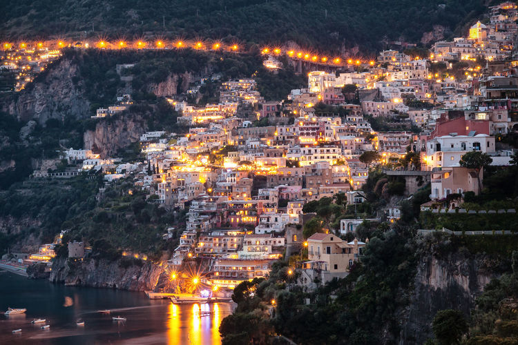 Positano profile view, with the street lights on. Aerial View Architecture Building Exterior City Cityscape Illuminated Light Night No People Outdoors Place Of Worship Positano Turistic