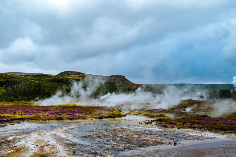Iceland Beauty In Nature Cloud - Sky Day Erupting Geyser Heat - Temperature Hot Spring Landscape Mountain Natural Phenomenon Nature No People Outdoors Power In Nature Scenics Sky Smoke - Physical Structure Steam Travel Destinations Volcanic Landscape Water