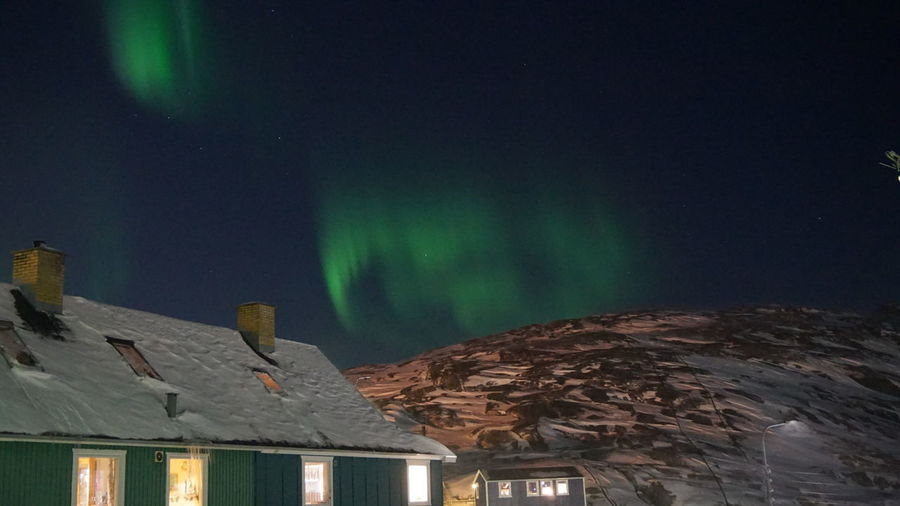 Dancing in the night, The aurora moves further away. Northern Lights Aurora The Real Greenland Ilulissat This Is Greenland Mountain Aurora Borealis Auroraborealis EyeEm Nature Lover EyeEm Best Shots - Nature Ilulissat Icefjord Night Nature Sky Snow Winter Scenics - Nature