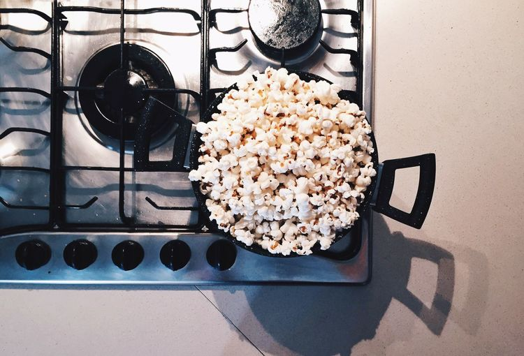High angle view of popcorns in frying pan on stove at kitchen