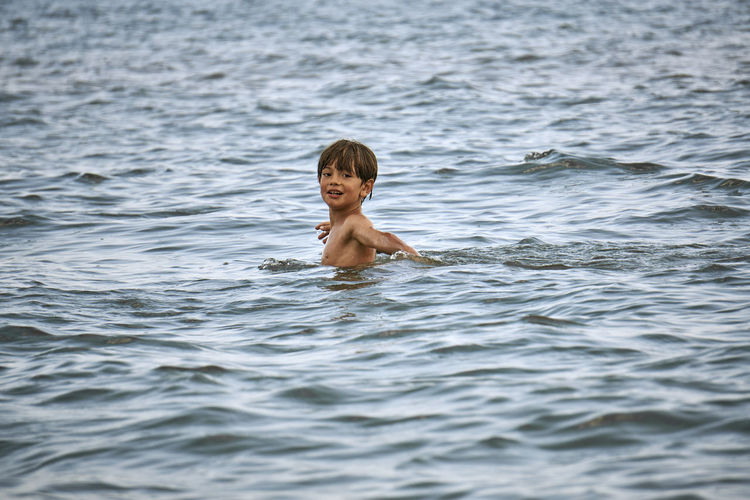 Water Games Boy Child Childhood Day Headshot Innocence Leisure Activity Lifestyles One Person Outdoors Overcast Portrait Pre-adolescent Child Real People Sea Shirtless Smiling Swimming Water Waterfront Wet Hair EyeEmNewHere