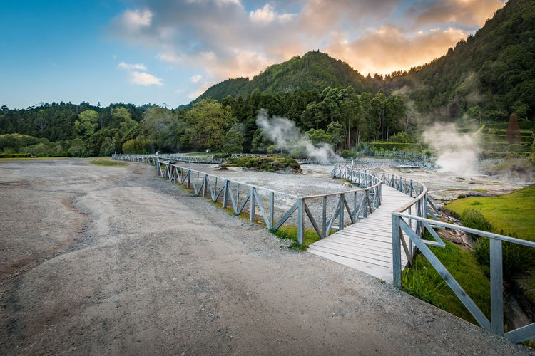 Fumarolas da Lagoa das Furnas, Açores Açores Furnas Most Sao Miguel Smoke Travel Beauty In Nature Cloud - Sky Day Environment Hot Spring Landscape Mountain Nature No People Outdoors Power In Nature Scenics - Nature Sky Smoke - Physical Structure Sunset Tree Water