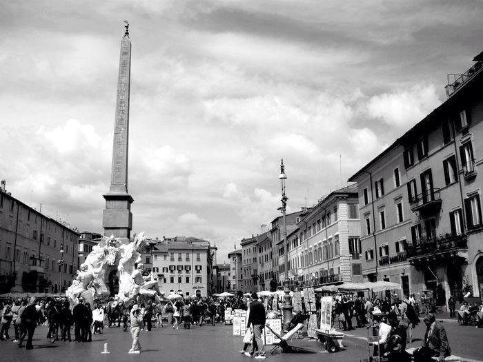 Fontana Dei Quattro Fiumi Against Sky With Tourist In Piazza Navona