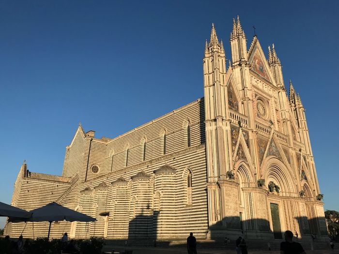 Duomo in the early evening light Cathedral Architecture Sky Built Structure Building Exterior Clear Sky Building Low Angle View Travel Destinations Place Of Worship Sunlight Belief Tower Travel Spirituality Blue Religion City Tourism Day