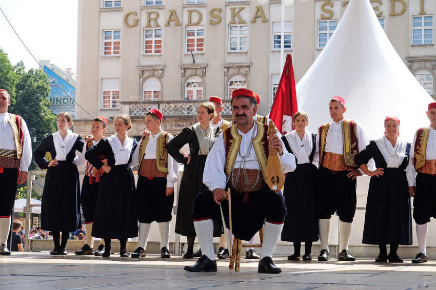 Members of folk group from Osojnik, Croatia during the 50th International Folklore Festival in center of Zagreb, Croatia on July 23, 2016 Celebration Costume Croatia Culture Dance Entertainment Event Festival Folk Folklore Heritage Historic Music Osojnik Participant Perform Style Tradition Zagreb