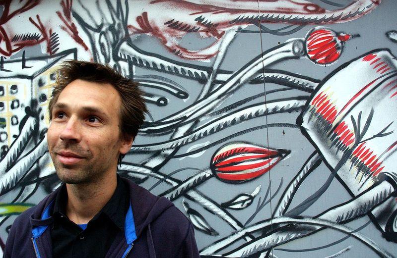 Man Standing Against Graffiti Wall