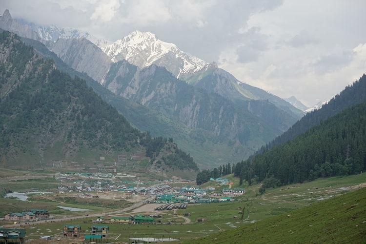 Village in valley amidst mountains
