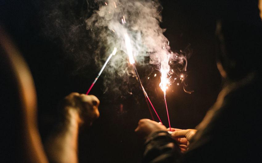 Man and woman burning at night