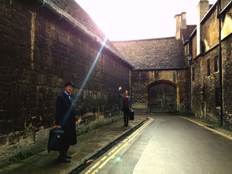 Oxford Alleyway Travelling Traveller Suitcase Waving Goodbye Architecture Sun Beams