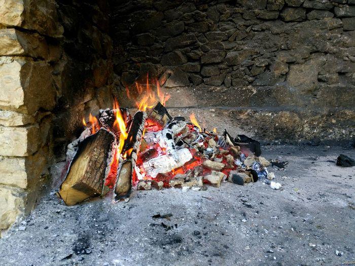 Logs burning at fireplace