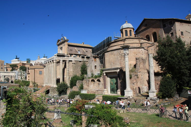 Old ruins at roman forum against clear sky